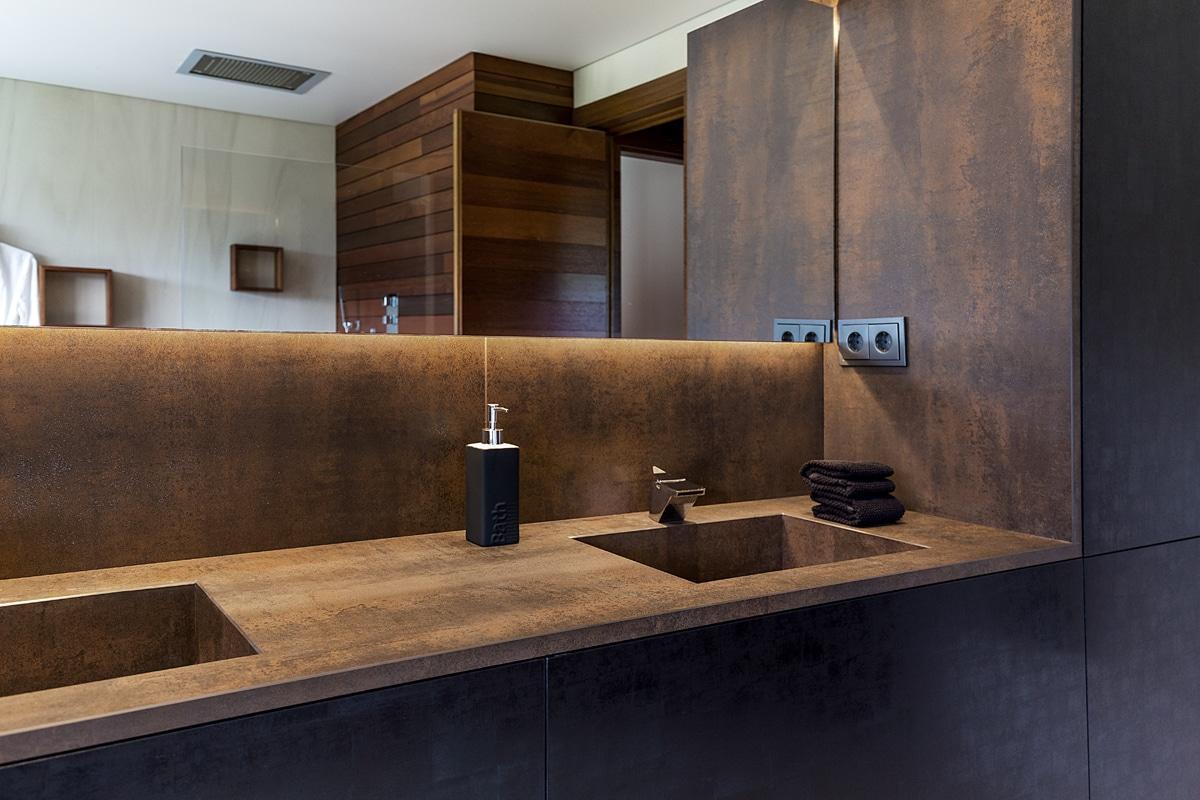UNIFAMILIAR SORT baño arena iron corten SUELO ARENA Marta Buira Ferré Arquitecta